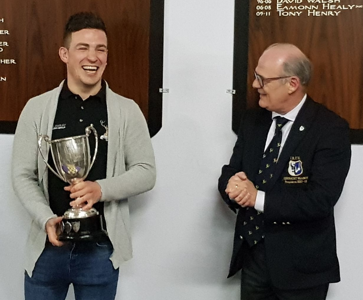 Creggs Captain Tom Callaghan having just received the Connacht J1B League Cup from Brian O'Beirn, President of the Connacht Branch of the IRFU.