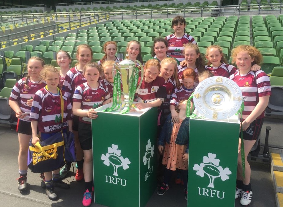 Creggs Rugby Under-12 Girls who conquered the Aviva, pictured with the 6 Nations and Triple Crown trophies